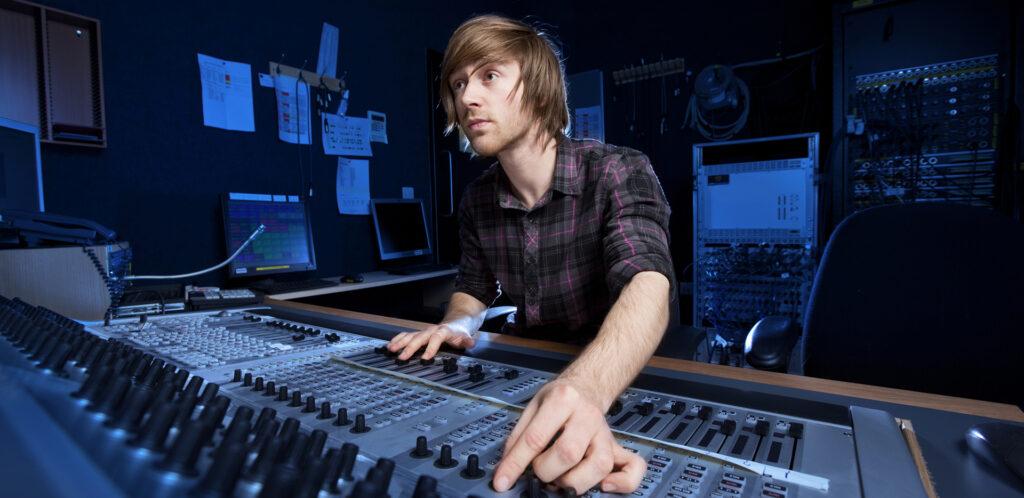 Audio Engineer Mixing Sound in Studio