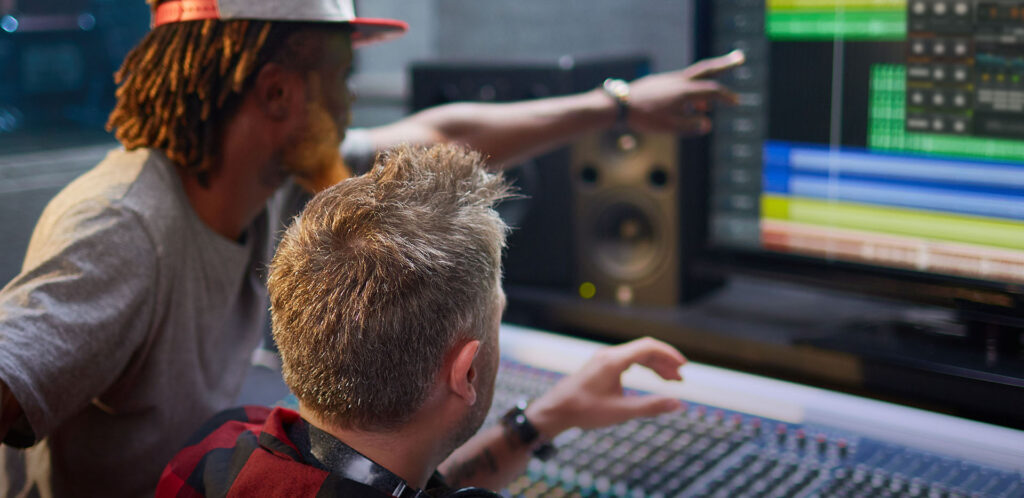 Two men use Waves Audio Essentials