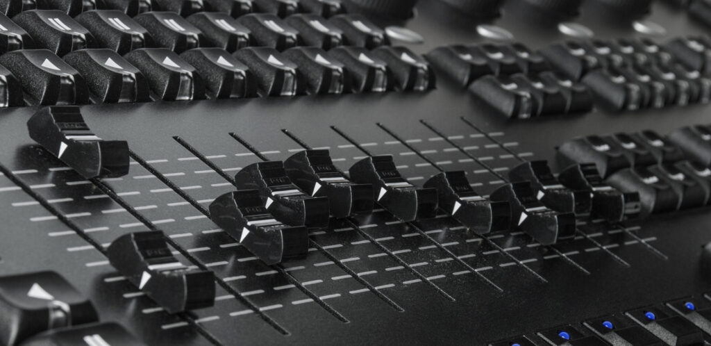 Modern audio desk with faders and buttons